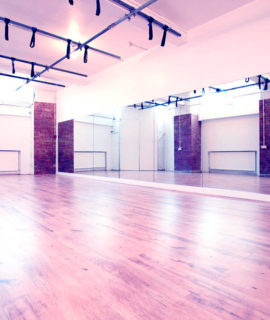 Studio Homepage image. LDA Studio 1 with aerial rig and purple tinge