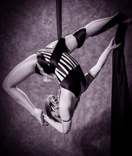 Jo aerial teacher for LDA in aerial silks shoot with purple tinge for home page image